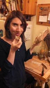 Sarah eating sourdough rye bread. Joyful disbelief.