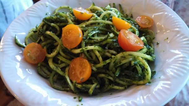 Zucchini pasta w/ pesto and cherry tomatoes