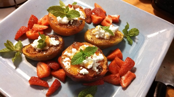 Browned peaches and figs stuffed with goat cheese and honey