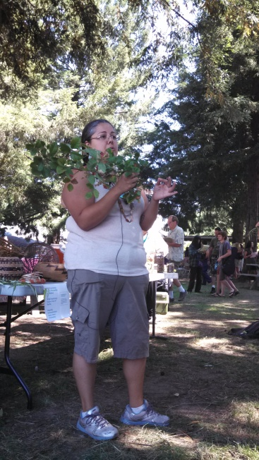 Here Corine shocks the audience by wielding a branch of poison oak and discussing it's many native uses and beneficial properties.